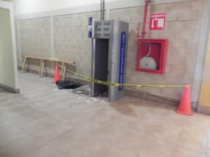 THE GUTS GONE and only the outer shell of the ATM remained the day after the robbery.(Staff Photo)
