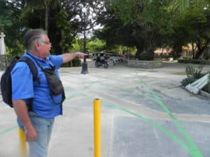 OPERATIONS MANAGER Eduardo Reynoso points to newly made but empty golf cart lot that is supposed to open car and truck parking in Centro. (Staff Photo)