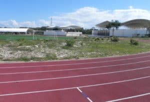 SPORTS COMPLEX in Puerto Maya has running track, soccer field, andconvered basketball courts, right and left buildings, and swim pool. center building. (Staff Photos)